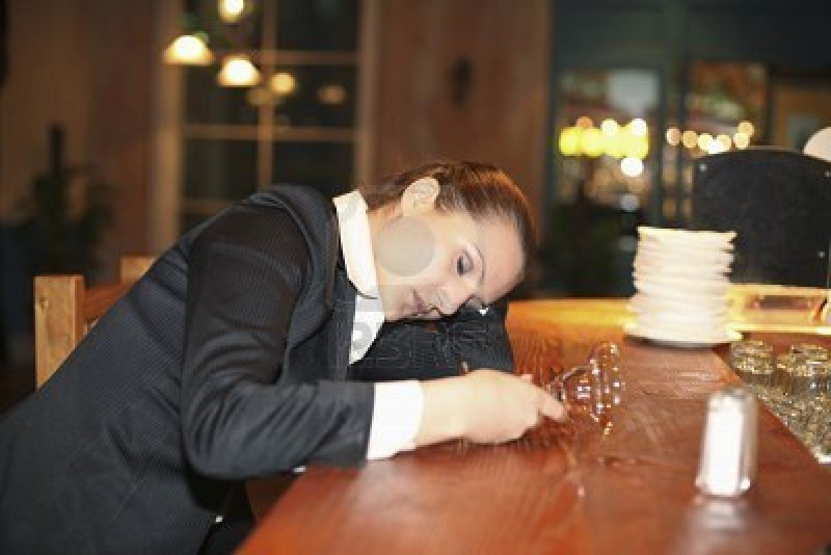 8148911-drunk-businesswoman-sleeping-on-bar-counter