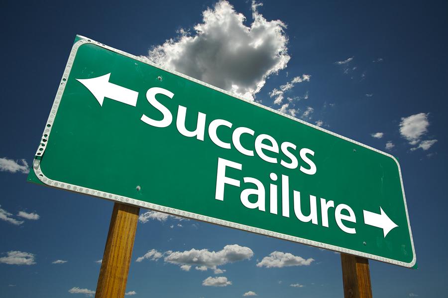 bigstockphoto_success_failure_road_sign_1967195